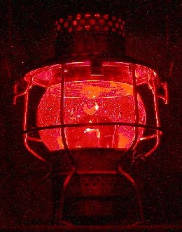 Illuminated red globe lantern